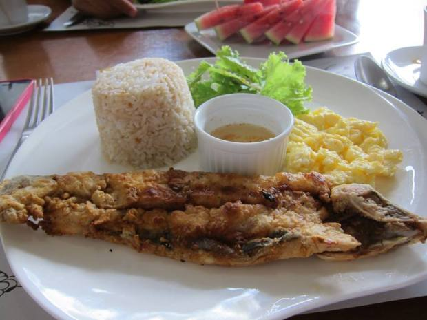Crispy fried Bangus with spiced vinegar, scrambled eggs and garlic rice - a Filipino classic.